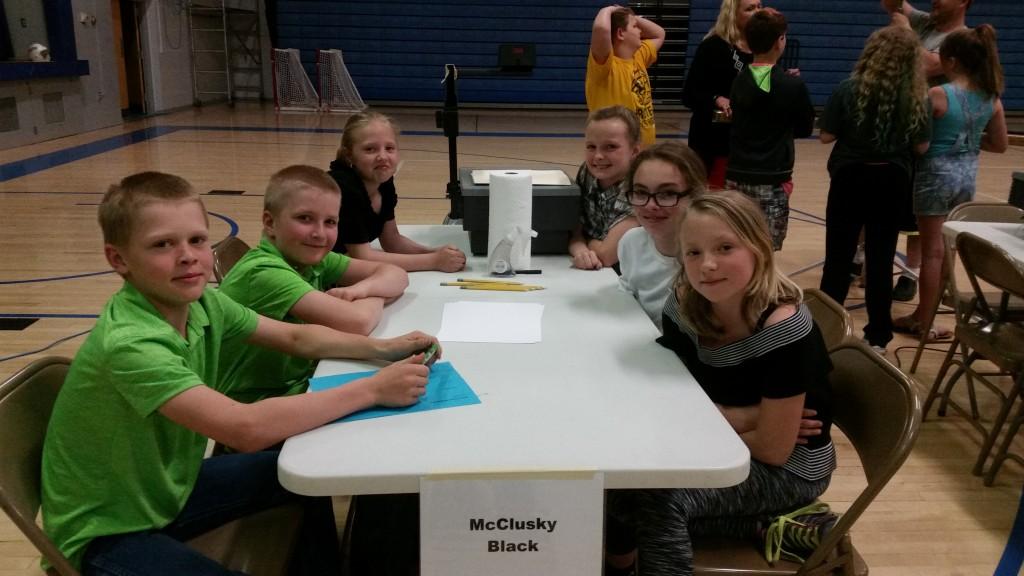 The 2016-17 Elementary Acalympic Team seated at the table in Velva.